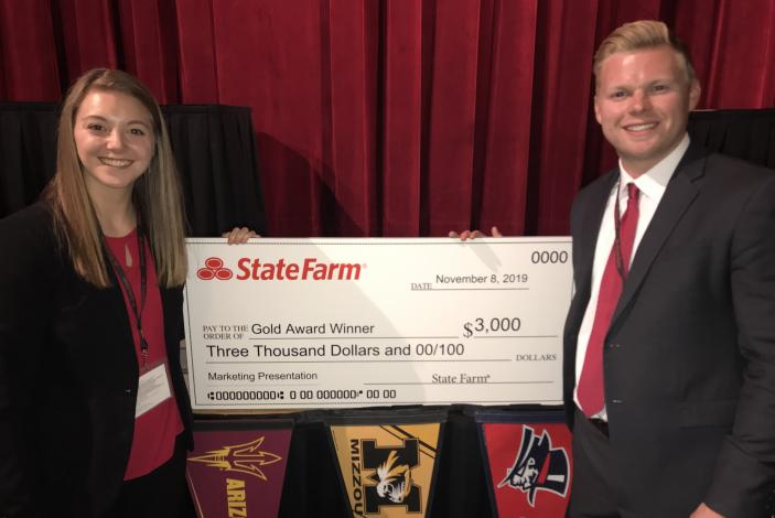 Image: Kristen Ross and Grant Garske holding a large prize check from State Farm.