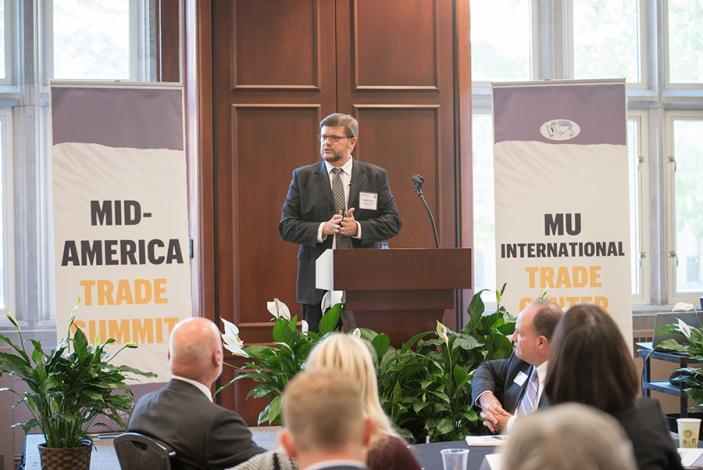 Image: Martin Butler speaks to the assembled group at the Mid-America Trade Summit